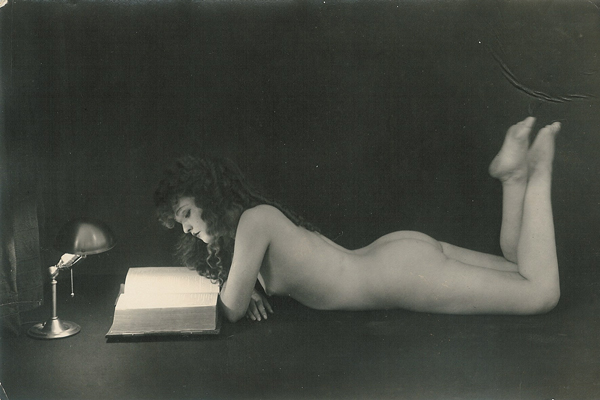 Woman naked reading